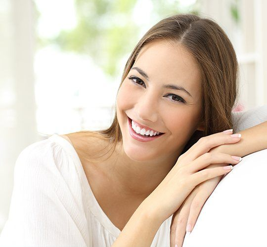 woman in white smiling