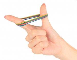 hand stretching a rubber band