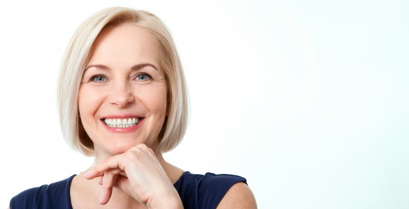 woman smiling after full mouth reconstruction